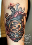 Amazing mechanical heart tattoo with elements to look almost like a real heart.