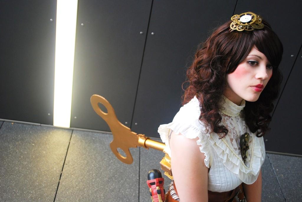 Steampunk wind up automaton girl with large brass key.